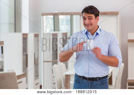 Sales assistant in furniture store