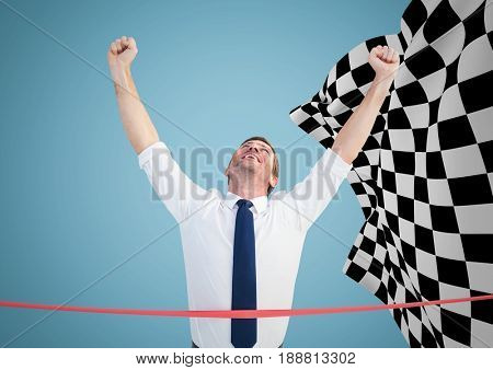 Digital composite of Business man at finish line against blue background and checkered flag