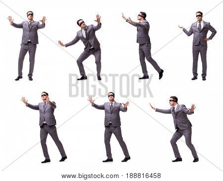 The blindfolded businessman isolated on white