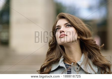 Young pretty girl, spring outdoor portrait. Beautiful female face.