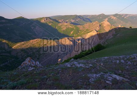 Summer landscape with a view of the mountain range. Sunny morning