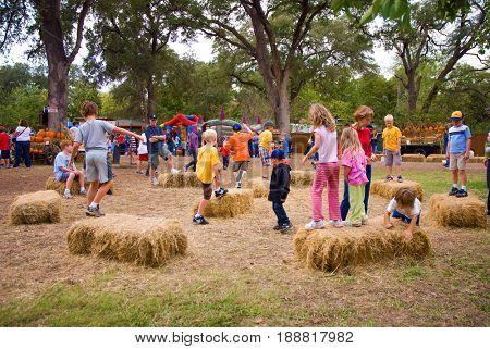 GRANITE BAY, CALIFORNIA, USA - October 18, 2009: Kids jumping and playing on hay bales at a pumpkin farm