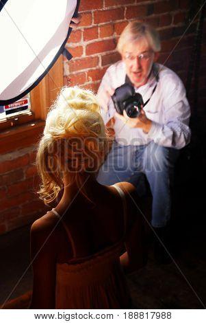SACRAMENTO, CALIFORNIA, USA - September 18, 2009: Blonde model poses for a photographer during Sacramento Fashion Week