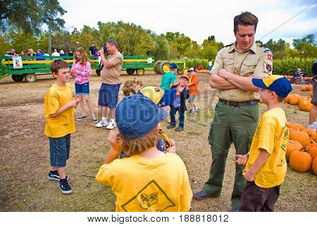 GRANITE BAY, CALIFORNIA, USA - October 18 2009: Cub Scout leader talks with boys in his den while on a field trip to a pumpkin farm
