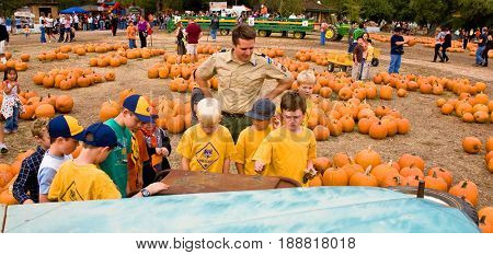 GRANITE BAY, CALIFORNIA, USA - October 18, 2009: Cubs Scouts and their leader examine a rusty old pickup truck with visiting a pumpkin farm on a field trip