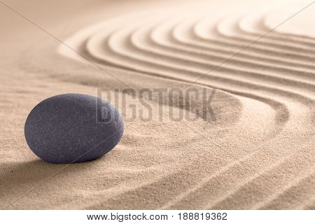 Spa wellness relaxing background with round sone on sand.