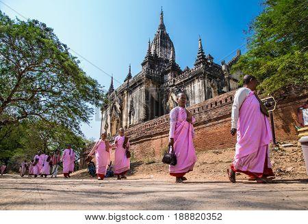 BAGAN, MYANMAR, MARCH 9, 2017: Buddhist nuns are walking in old Bagan on March 9, 2017. Myanmar. (Burma)