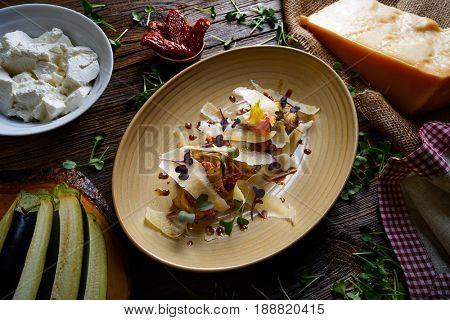 Aubergine and cheese recipe italian food on wood table