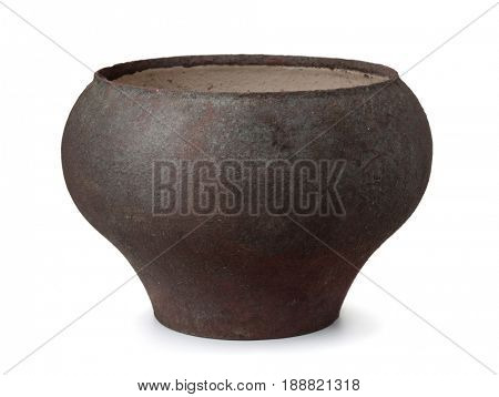 Old cast iron oven pot isolated on white