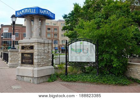 NAPERVILLE, ILLINOIS - MAY 26, 2017: Signs at the entrance to the Naperville Riverwalk along the West Branch of the DuPage River through Naperville, Illinois.
