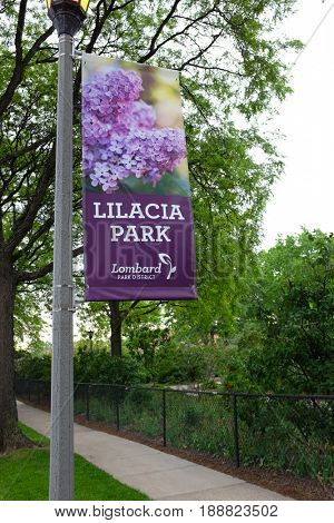 LOMBARD, ILLINOIS - MAY 26, 2017: Lilacia Park banner. Once home to Colonel William R. Plum's lilac garden the park was bequeathed on the passing of Colonel Plum in 1927.