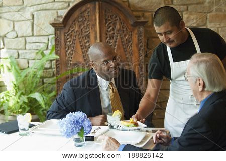 Businessmen having lunch in restaurant