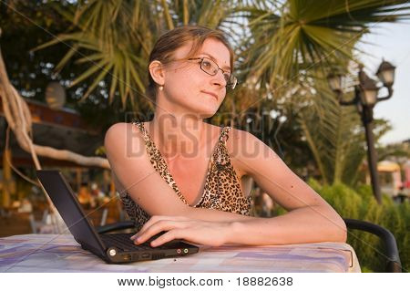 young woman with black laptop