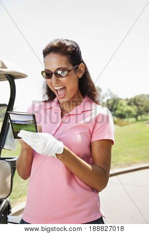 Woman keeping score during golf game