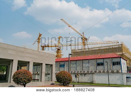 SHANGHAI CHINA APRIL 2017 : A crane is working on building construction site at Hi-Tech park industrial estate