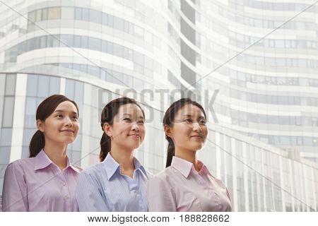 Smiling Chinese businesswomen