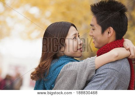 Smiling Chinese couple hugging