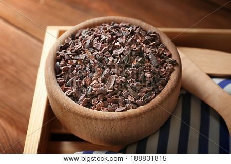 Composition with cocoa nibs on wooden table