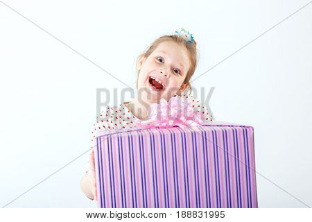 Little girl is happy with the gift in her hands
