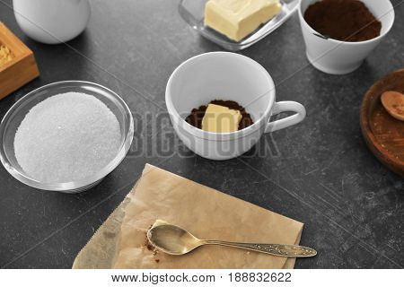 Ingredients for bulletproof coffee on gray background