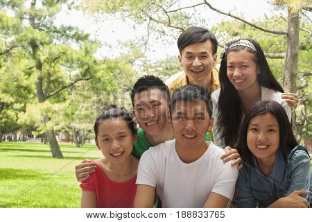 Group of Chinese friends smiling in park