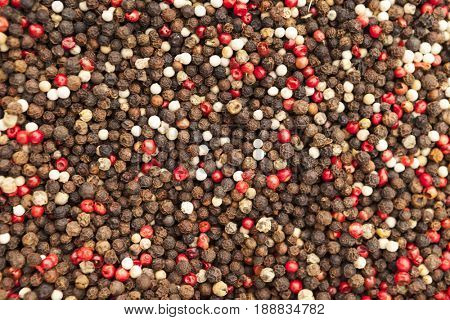 Hot pepper seeds. Red, black and white pepper closeup on rustic market