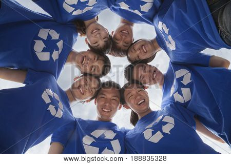 Group of Chinese friends wearing recycle t-shirts