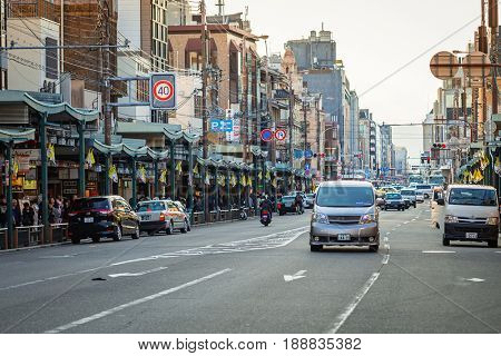 KYOTO, JAPAN - NOVEMBER 11, 2016: Cars on the street of Kyoto in Japan. Kyoto Metropolis is one of the most populous city of Japan.