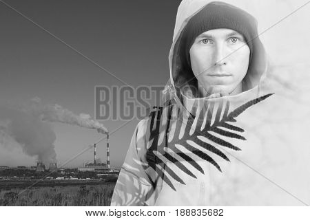 Face of young man hiker and steaming smokestacks. Double exposure effect photography.