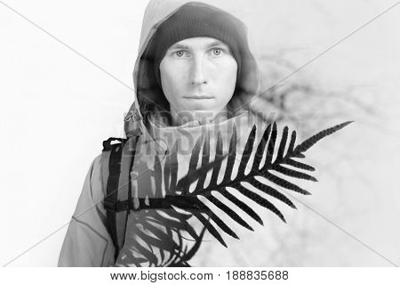 Double exposure effect photography. Hiker man face and leaf of a plant.
