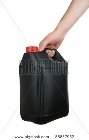 Human hand holding black plastic jerrycan on white background