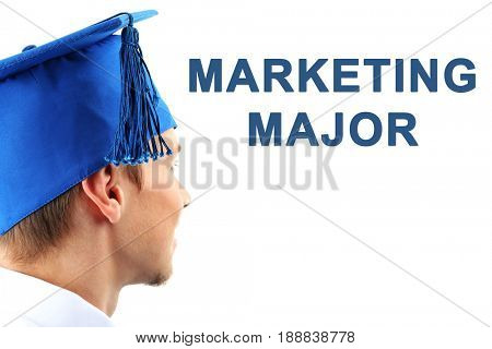 Marketing major concept. Student in graduation cap on white background