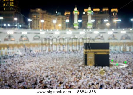 Muslims pilgrims from all around the world circumabulate (tawaf) the Kaaba at Masjidil Haram, Mecca, Saudi Arabia (blurred image without focus)