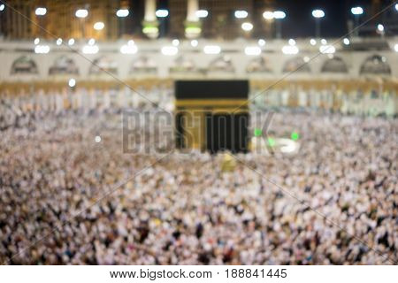Blurred image of Kaaba in Makkah with people