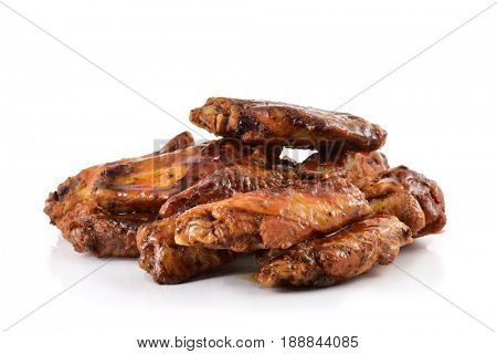 closeup of some barbecue chicken wings on a white background