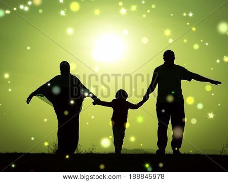 Silhouette of happy family holding each other hands