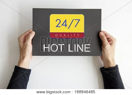 Hands holding a banner with 24/7 service