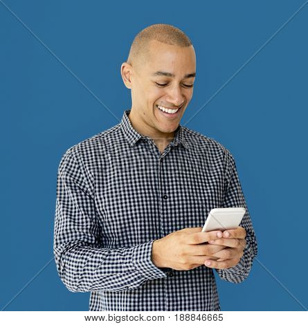 A guy is smiling using smartphone