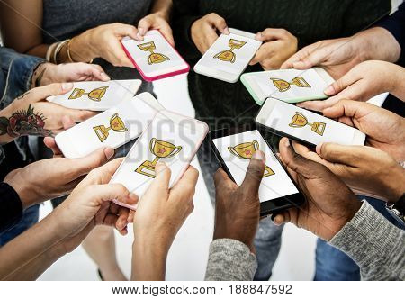 Hands holding digital device network graphic overlay