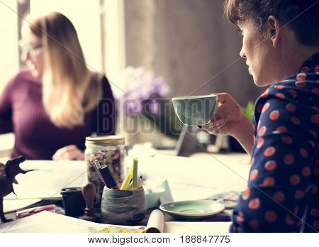 Woman Sipping Coffee from Cup on Office