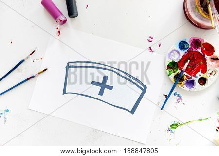 Child with a drawing of nurse hat