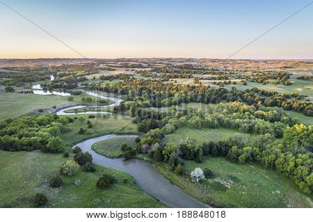 aerial view of Dismal River in Nebraska Sand Hills near Thedford, spring scenery lit by sunrise light