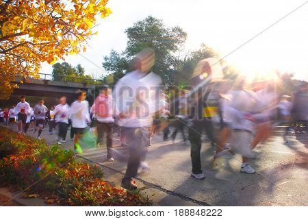 SACRAMENTO, CALIFORNIA, USA - November 26, 2009: People running in motion during an early Thanksgiving morning Run to Feed the Hungry race
