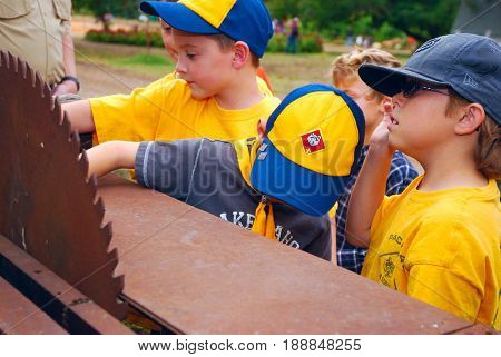 GRANITE BAY, CALIFORNIA, USA - October 18, 2009: Cub Scouts examine an antique saw blade while on a field trip to a pumpkin farm