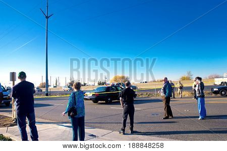 SACRAMENTO, CALIFORNIA, USA - December 2, 2009: Curious onlookers line up along a crime scene tape barrier during an armed standoff