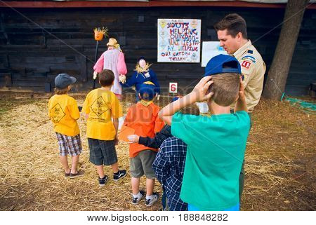 GRANITE BAY, CALIFORNIA, USA - October 18, 2009: Cub Scouts on a pumpkin farm field trip looking at a display created by another local pack