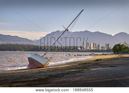 Beached Sailboat, Kitsilano, Vancouver. A beached sailboat the day after a storm hits Vancouver, British Columbia.