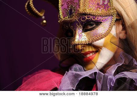 young sexy woman in violet party half mask. may be use for fashion makeup concept poster