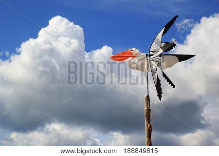 Travel To Island Koh Lanta, Thailand. The Bird-weather Vane On The Background Of Cloudy Sky.