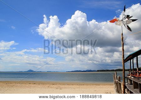 Travel To Island Koh Lanta, Thailand. The Bird-weather Vane On The Background Of Cloudy Sky, Blue Se